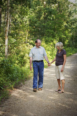 fifty something: Husband and wife on walking trail Stock Photo