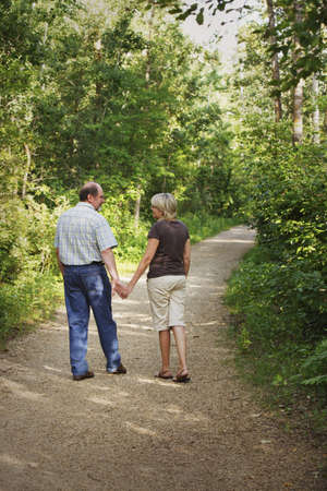 50 something fifty something: Husband and wife on walking trail Stock Photo