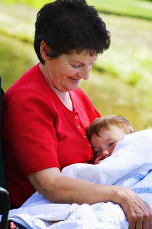 seventy something: A woman holding her grandson