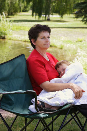 sixty something: A woman holding her grandson