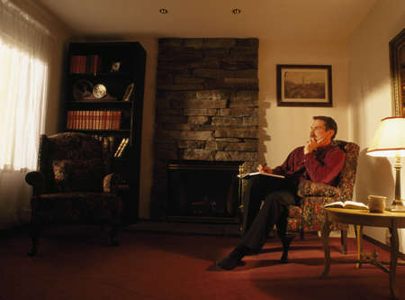 50 something fifty something: A man sitting in his study Stock Photo