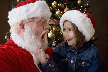 seventy something: Santa Claus with a girl
