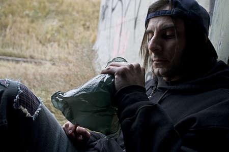 thirtysomething: Man with bottle of alcohol Stock Photo