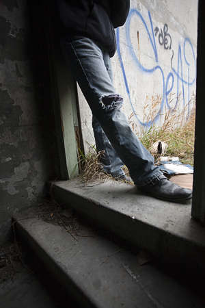 hang body: Person beside graffiti