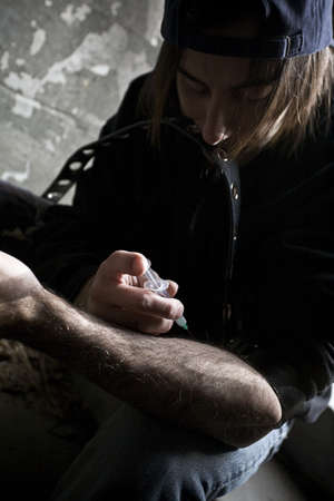 twentysomething: Man injecting drugs