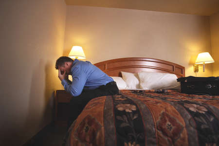 belief system: A businessman in hotel room