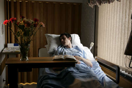 hospital: Man in a hospital bed Stock Photo