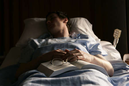 hurting: Man in a hospital bed Stock Photo