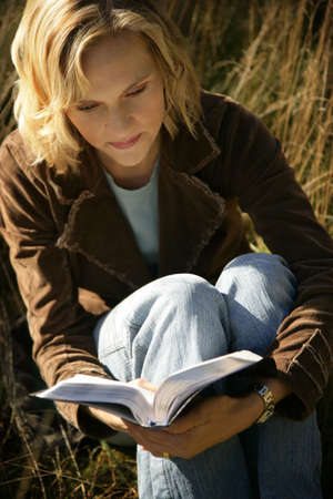 bookish: Woman reading her Bible