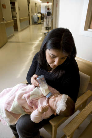Woman bottle feeding baby girl Stock Photo - 7206988