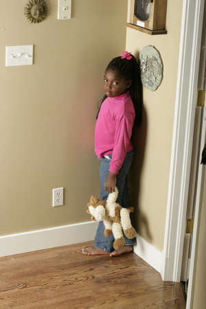 disobedient: Girl standing in the corner Stock Photo