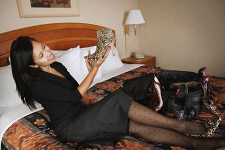 Woman admiring new shoes photo