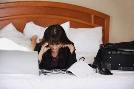 Woman working on bed Stock Photo - 7205284