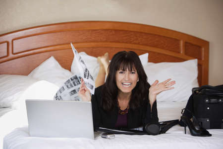 Woman working on bed photo