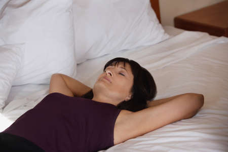 fifty something: Woman lying on bed