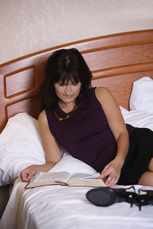 50 something fifty something: Woman reading the Bible Stock Photo