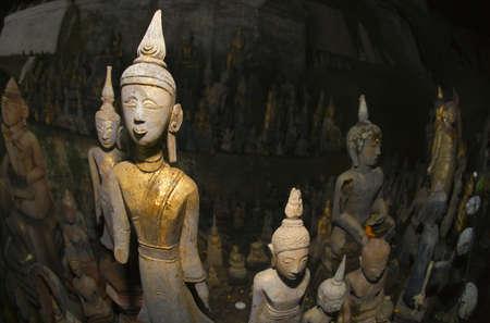 historical periods: Buddha statues, Pak Ou caves, Laos Stock Photo