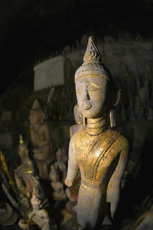 idolatry: Buddha statues, Pak Ou caves, Laos Stock Photo