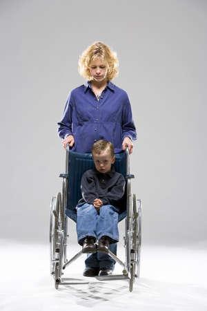 車椅子の子供を持つ母 写真素材