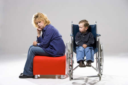 family units: Mother with son in wheelchair