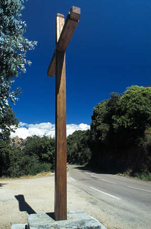 Wooden cross erected by the side of the road in Corsica, France