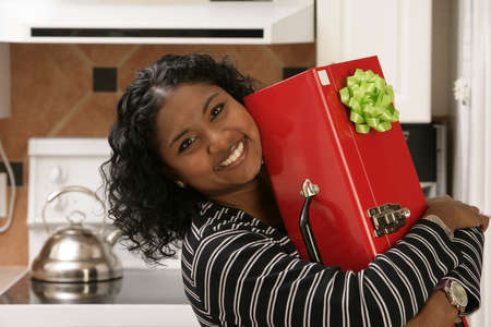 30 something: Woman carrying toolbox with bow