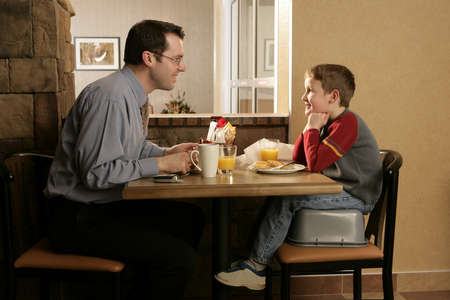 family units: Father and son eating together