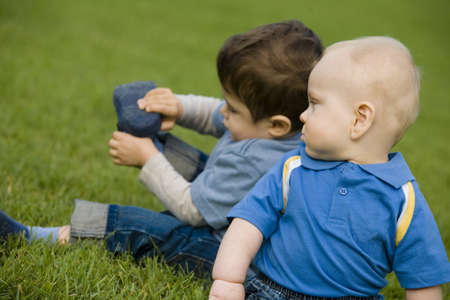 predicament: Two boys sitting on grass