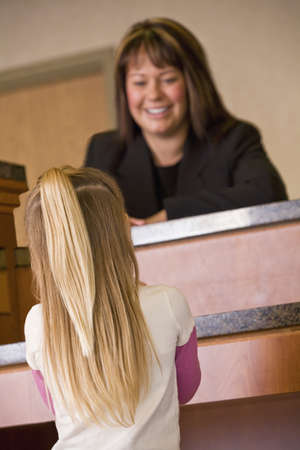accommodations: Girl at service desk