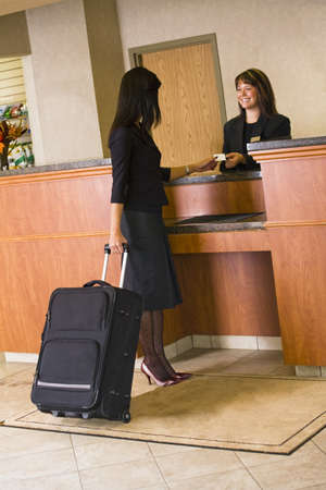 hotel: Woman checking in at hotel lobby