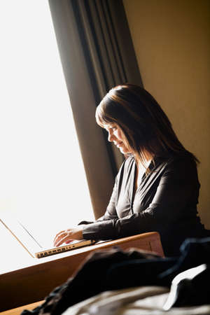 Woman working on computer photo