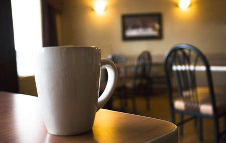 coffee cups: Coffee mug on table