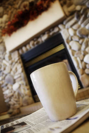 Coffee mug on table with newspaper Stock Photo - 7207252