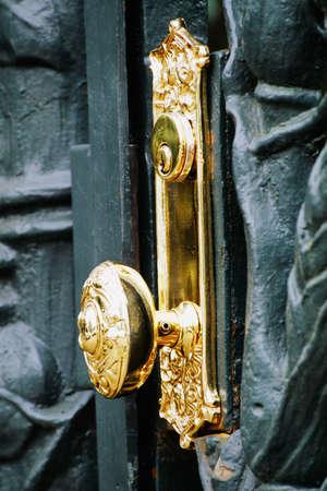 fullframes: Golden doorknob on cast-iron gate