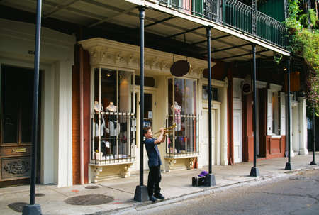 storefront: Boy playing trumpet in historic French Quarter, New Orleans, Louisiana   Stock Photo
