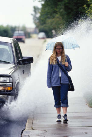 sidewalks: Girl walking in the rain