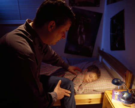 Father praying for son Stock Photo - 7207042