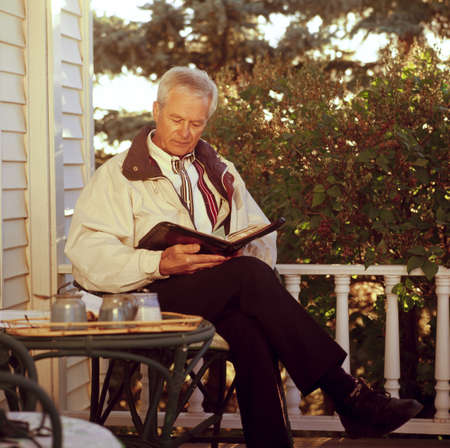 seventy something: A man reading his Bible Stock Photo