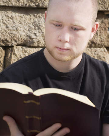 bookish: Man reading Bible Stock Photo
