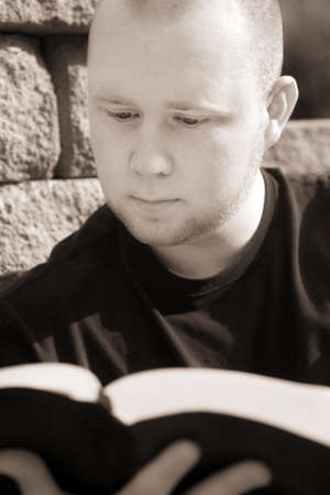 bookish: Man reading his Bible Stock Photo