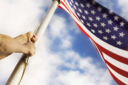 Raising an American flag photo