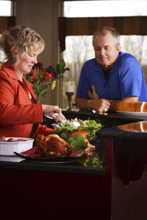 50 something fifty something: Couple making dinner