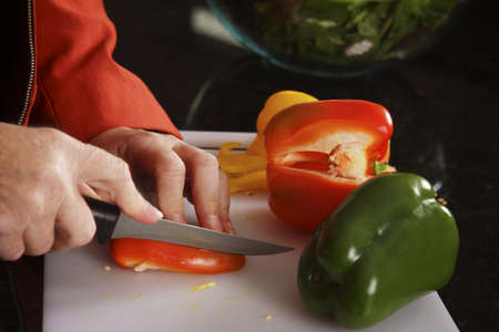 caterers: Slicing peppers Stock Photo