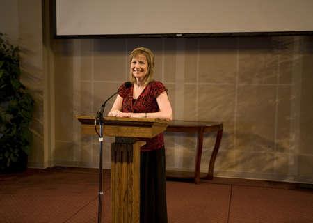 minister: A woman giving a speech Stock Photo
