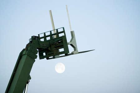 tanasiuk: Boom lift with rising moon