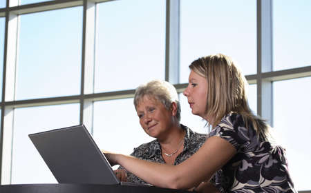 sixty something: Two women looking at personal computer
