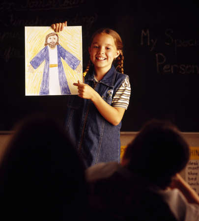 christian faith: Child with picture of Jesus