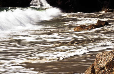 Waves crashing along shoreline