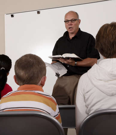 50 something fifty something: Man teaching students Stock Photo