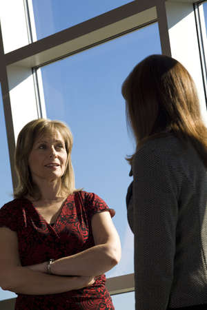 50 something fifty something: Two women talking Stock Photo
